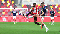 Brentford's Rico Henry tries to control the ball under pressure from Lewis Wing of Middlesbrough during Brentford vs Middlesbrough, Sky Bet EFL Championship Football at the Brentford Community Stadium on 7th November 2020