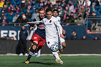 FOXBOROUGH, MA - MARCH 7: Alvaro Medran #10 of Chicago Fire clears the ball as Adam Buksa #9 of New England Revolution closes during a game between Chicago Fire and New England Revolution at Gillette Stadium on March 7, 2020 in Foxborough, Massachusetts.
