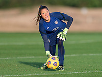ORLANDO, FL - JANUARY 21: Aubrey Bledsoe #21 of the USWNT rolls out the ball during a training session at the practice fields on January 21, 2021 in Orlando, Florida.