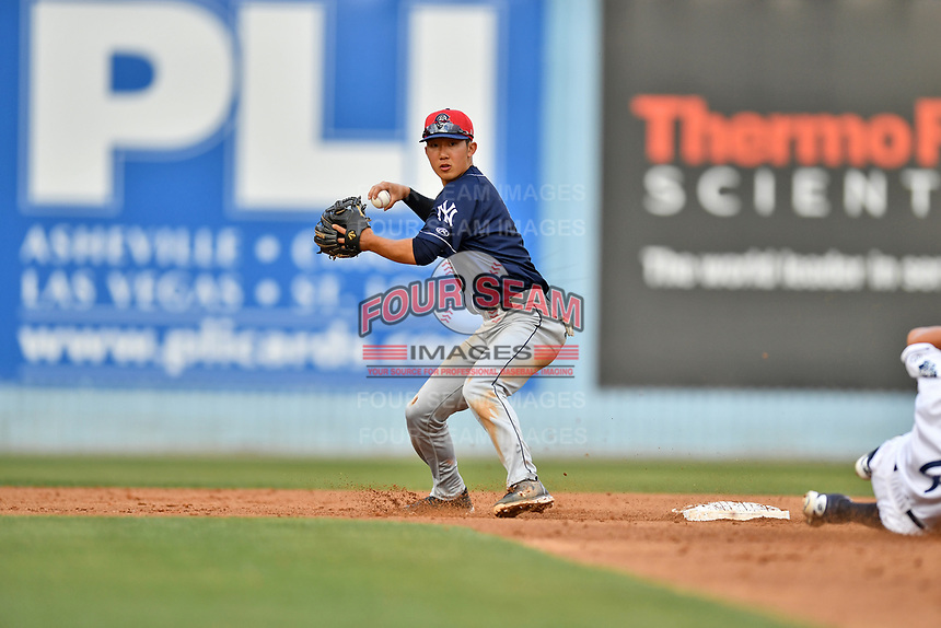 Charleston RiverDogs shortstop Hoy Jun Park (1) makes the throw to complete a double play during over a hard sliding Jose Gomez (4) during during a game against the Asheville Tourists at McCormick Field on July 4, 2017 in Asheville, North Carolina. The Tourists defeated the RiverDogs 2-1. (Tony Farlow/Four Seam Images)