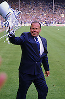 16 May 1987: Coventry City managing director George Curtis celebrates on the pitch after his team defeat Tottenham Hotspur 3-2 in the FA Cup Final at Wembley Photo: actionplus...soccer football joy celebrate celebration 870516