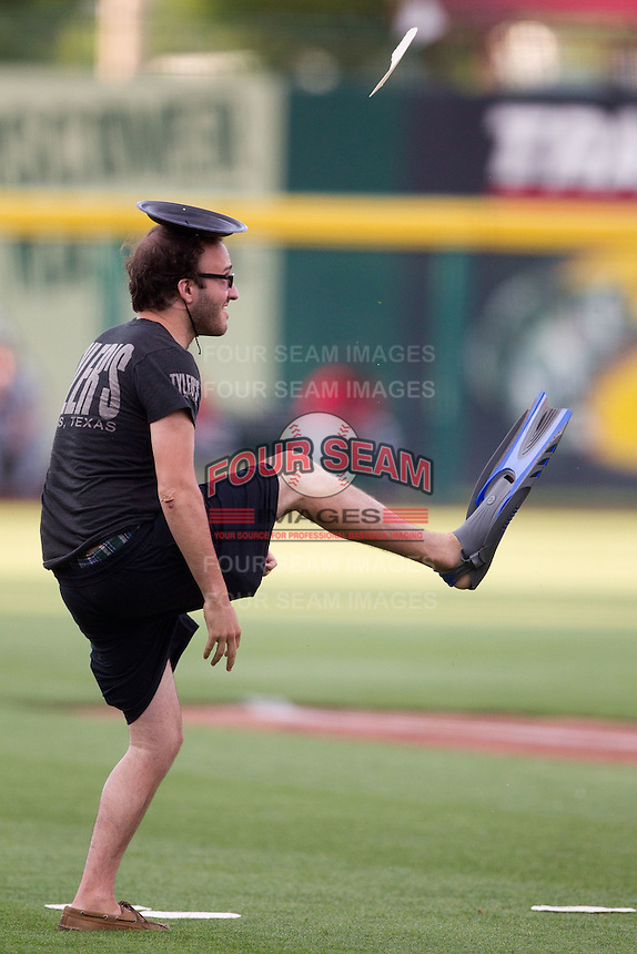 A fan tries to flip a tortilla onto his head while wearing swim fins during a competition during a game between the Arkansas Travelers and the Springfield Cardinals at Hammons Field on June 13, 2012 in Springfield, Missouri. (David Welker/Four Seam Images).