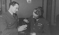 BNPS.co.uk (01202) 558833<br /> Pic: MarlowsAuctioneers/BNPS<br /> <br /> Pictured: Flight Lieutenant Maxwell Sparks (right) with a fellow pilot.<br /> <br /> The medals of a hero of the legendary Operation Jericho raid who dive-bombed a Gestapo prison at just 10ft have sold for over £15,000.<br /> <br /> Flight Lieutenant Maxwell Sparks pulled off the daring manoeuvre during the daylight attack on the heavily-defended Amiens Prison in northern France in February 1944.<br /> <br /> Positioned third in the attack's first wave, he bombarded the German guards' quarters at 'tree-top height' then ascended just in time to miss the prison's roof.