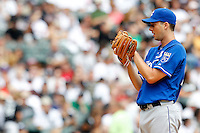 Kansas City Royals starting pitcher Jeff Francis #26 prepares to deliver a pitch during a game against the Chicago White Sox at U.S. Cellular Field on August 14, 2011 in Chicago, Illinois.  Chicago defeated Kansas City 6-2.  (Mike Janes/Four Seam Images)