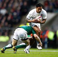 Photo: Richard Lane/Richard Lane Photography. England v Ireland. 17/03/2012. England's Manu Tuilagi is tackled b y Ireland's Gordon D'Arcy.