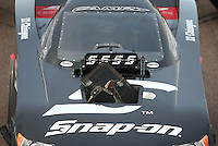 Feb 20, 2015; Chandler, AZ, USA; Detailed view of the broken burst panel on the car of NHRA funny car driver Cruz Pedregon after an explosion during qualifying for the Carquest Nationals at Wild Horse Pass Motorsports Park. Mandatory Credit: Mark J. Rebilas-