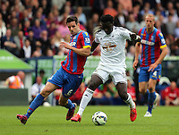 Pictured L-R: Scott Dann of Crystal Palace challenges Bafetimbi Gomis of Swansea<br />