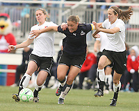 Abby Wambach (blue) of the Washington Freedom rushes for the ball in between Keely Dowling and Jen Buczkowski of Sky Blue F.C. during a WPS pre season match at Maryland Soccerplex,in Boyd's, Maryland on March 14 2009. Sky Blue won the match 1-0