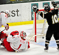 2 January 2011: Army Black Knight forward Drew Pierson, a Senior from Pleasant Prairie, WI, celebrates a goal against the Ohio State University Buckeyes at Gutterson Fieldhouse in Burlington, Vermont. The Buckeyes defeated the Black Knights 5-3 to win the 2010-2011 Catamount Cup. Mandatory Credit: Ed Wolfstein Photo