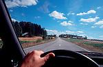 Finland, Driver's view of a road through summer fields, Scandinavia, Europe.
