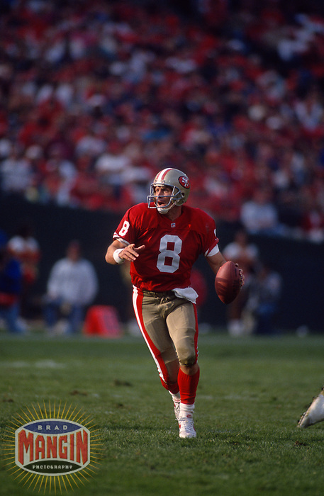 SAN FRANCISCO, CA:  Quarterback Steve Young of the San Francisco 49ers in action during a game against the New Orleans Saints at Candlestick Park in San Francisco, California on November 15, 1992. (Photo by Brad Mangin)
