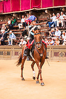 It is part of the tradition that a horse mounted squadron of Carabinieri open the Parade of the Palio di Siena