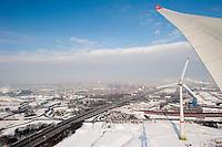 GERMANY Hamburg , Enercon windmill E-126 with 6 MW during Winter, port and skyline of Hamburg / Deutschland Hamburg , Enercon Windrad E-126 mit 6 MW in Altenwerder,  Hintergrund Hafen und city skyline im Winter