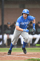 Center fielder Ben Aklinski (52) of the Kentucky Wildcats trots to first on a walk in a game in the rain against the University of South Carolina Upstate Spartans on Saturday, February 17, 2018, at Cleveland S. Harley Park in Spartanburg, South Carolina. Kentucky won, 6-5, in 10 innings. (Tom Priddy/Four Seam Images)