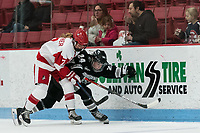 BOSTON, MA - JANUARY 11: Jesse Compher #7 of Boston University and Hayley Lunny #24 of Providence College battle for the puck during a game between Providence College and Boston University at Walter Brown Arena on January 11, 2020 in Boston, Massachusetts.