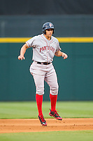 Garin Cecchini (3) of the Pawtucket Red Sox takes his lead off of second base against the Charlotte Knights at BB&T Ballpark on August 9, 2014 in Charlotte, North Carolina.  The Red Sox defeated the Knights  5-2.  (Brian Westerholt/Four Seam Images)