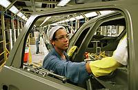 Jeane Taiza Silva  21 anos   Operadora trabalhando na  Limpeza do PVC na Fábrica da Ford instalada no polo industrial do município de Camaçarí na Bahia Brasil.<br />Foto Paulo Santos/Interfoto<br />09/06/2003