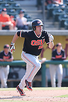 Gabe Clark #16 of the Oregon State Beavers runs to first base during a game against the Southern California Trojans at Dedeaux Field on May 23, 2014 in Los Angeles, California. Southern California defeated Oregon State, 4-2. (Larry Goren/Four Seam Images)