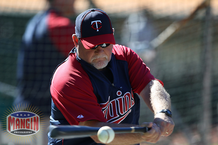 OAKLAND, CA - JUNE 5:  Manager Ron Gardenhire #35 of the Minnesota Twins hits fungoes before the game against the Oakland Athletics at the Oakland-Alameda County Coliseum on June 5, 2010 in Oakland, California. Photo by Brad Mangin