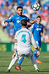Jorge Molina Vidal of Getafe CF (top) fights for the ball with Sergio Ramos of Real Madrid  during the La Liga 2017-18 match between Getafe CF and Real Madrid at Coliseum Alfonso Perez on 14 October 2017 in Getafe, Spain. Photo by Diego Gonzalez / Power Sport Images