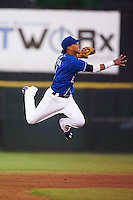 Biloxi Shuckers shortstop Orlando Arcia (2) follows through on a throw to first during a game against the Birmingham Barons on May 23, 2015 at Joe Davis Stadium in Huntsville, Alabama.  Birmingham defeated Biloxi 2-0 as the Shuckers are playing all games on the road, or neutral sites like their former home in Huntsville, until the teams new stadium is completed in early June.  (Mike Janes/Four Seam Images)