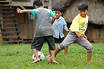 Mayan boys play barefoot soccer in a village lot in Crique Sarco, southern Belize - one of several villages bordering Sarstoon-Temash National Park