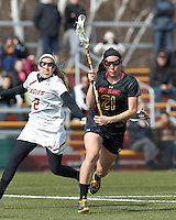 University of Maryland midfielder Taylor Cummings (21) on the attack. .University of Maryland (black) defeated Boston College (white), 13-5, on the Newton Campus Lacrosse Field at Boston College, on March 16, 2013.