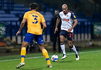 Bolton Wanderers' Alex John-Baptiste (right) challenging Mansfield Town's Malvind Benning<br /> <br /> Photographer Andrew Kearns/CameraSport<br /> <br /> The EFL Sky Bet League Two - Bolton Wanderers v Mansfield Town - Tuesday 3rd November 2020 - University of Bolton Stadium - Bolton<br /> <br /> World Copyright © 2020 CameraSport. All rights reserved. 43 Linden Ave. Countesthorpe. Leicester. England. LE8 5PG - Tel: +44 (0) 116 277 4147 - admin@camerasport.com - www.camerasport.com