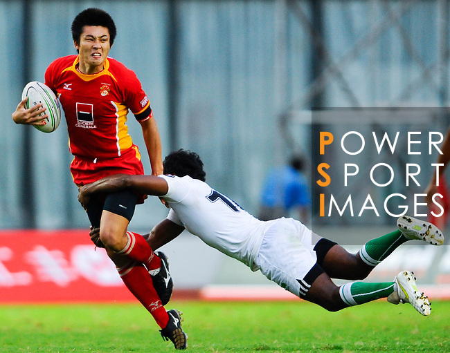 China men play Sri Lanka during Day 1 of the Shanghai Sevens, as part of the HSBC Asian Sevens Series, at the Yuanshen stadium on August 27, 2011 in Shanghai, China. Photo by © Photo by © Victor Fraile / The Power of Sport Images for Fast Track / HSBC