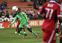 WASHINGTON, DC. - AUGUST 22, 2012:  Bill Hamid (28) of DC United moves on a ball from Alex (71) of the Chicago Fire during an MLS match at RFK Stadium, in Washington DC,  on August 22. United won 4-2.