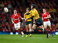 Photo: Richard Lane/Richard Lane Photography. Wales v Australia. Autumn International. 03/12/2011. Australia's Berrick Barnes passes.