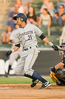 Kelvin Castro #29 of the Charleston RiverDogs follows through on his swing against the Kannapolis Intimidators at Fieldcrest Cannon Stadium May 29, 2010, in Kannapolis, North Carolina.  Photo by Brian Westerholt / Four Seam Images