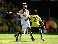 Andre Ayew of Swansea battles with Valon Behrami of Watford and Ikechi Anya of Watford   during the Barclays Premier League match Watford and Swansea   played at Vicarage Road Stadium , Watford