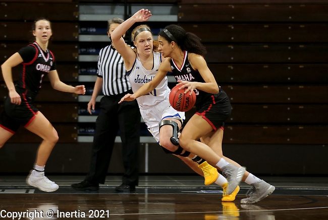 SIOUX FALLS, SD - MARCH 6: Mariah Murdie #33 of the Omaha Mavericks drives to the basket against Tori Nelson #20 of the South Dakota State Jackrabbits during the Summit League Basketball Tournament at the Sanford Pentagon in Sioux Falls, SD. (Photo by Dave Eggen/Inertia)