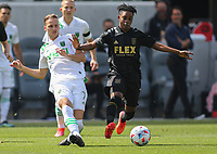 LOS ANGELES, CA - APRIL 17: Tomás Pochettino #7 of Austin FC battles with Latif Blessing #7 of LAFC during a game between Austin FC and Los Angeles FC at Banc of California Stadium on April 17, 2021 in Los Angeles, California.
