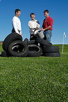 John Stier, associate professor of horticulture (L), Jim Park, professor of civil and environmental engineering (center) and Bob Lisi, graduate student in civil and environmental engineering (R), hold a bucket of shredded tire chips at the University Ridge golf course, adjacent to the O.J. Noer Turfgrass Research Facility where they have conducted research on the impact of fertilizers and pesticides. The researchers found that shredded tires placed beneath golf course greens can absorb excess nitrates and other chemicals from fertilizers.<br /> <br /> Client: University of Wisconsin-Madison<br /> © UW-Madison University Communications 608-262-0067<br /> Photo by: Michael Forster Rothbart<br /> Date:  9/03    File#:   D100 digital camera frame 10175.