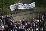 Newcastle United 1 Tottenham Hotspur 3 19/04/2015. St James Park, Premier League. Supporters fixing a protest banner to a fence at the Gallowgate end of the stadium before Newcastle United host Tottenham Hotspurs in an English Premier League match at St. James' Park. The match was boycotted by a section of the home support critical of the role of owner Mike Ashley and sponsorship by a payday loan company. The match was won by Spurs by 3-1, watched by 47,427, the lowest league gate of the season at the stadium. Photo by Colin McPherson.