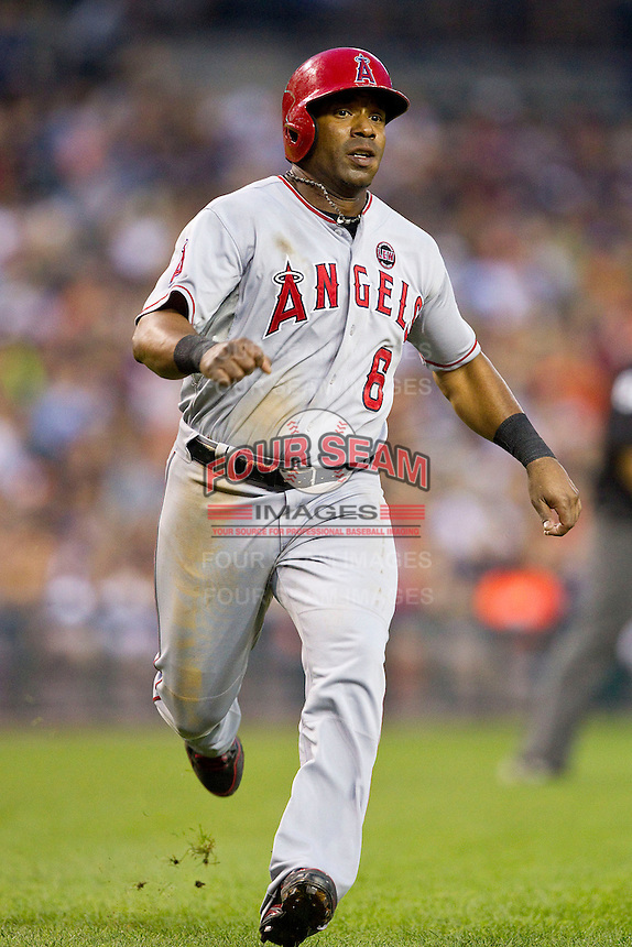 Alberto Callaspo (6) of the Los Angeles Angels hustles down the third base line on his way to scoring a run against the Detroit Tigers at Comerica Park on June 25, 2013 in Detroit, Michigan.  The Angels defeated the Tigers 14-8.  (Brian Westerholt/Four Seam Images)