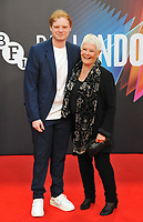 """Sam Williams and  Dame Judi Dench at the 65th BFI London Film Festival """"Belfast"""" American Airlines gala, Royal Festival Hall, Belvedere Road, on Tuesday 12th October 2021, in London, England, UK.  <br /> CAP/CAN<br /> ©CAN/Capital Pictures"""