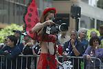 WOMEN DRESSED AS LADYBUG TAKES PHOTOS AT GAY PRIDE PARADE