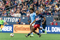 FOXBOROUGH, MA - SEPTEMBER 11: Andrew Farrell #2 of New England Revolution passes the ball as Talles Magno #43 of New York City FC defends during a game between New York City FC and New England Revolution at Gillette Stadium on September 11, 2021 in Foxborough, Massachusetts.