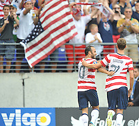 Clarence Goodson (21) of the USMNT celebrates with teammate Landon Donovan his score.  The USMNT defeated El Salvador 5-1 at the quaterfinal game of the Concacaf Gold Cup, M&T Stadium, Sunday July 21 , 2013.