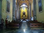 Three Roman Catholic church goers inside church