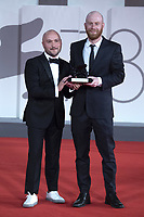 """Lucas Engel poses with Orizzonti Award for the Best Short Film for """"Los Huesos"""" during the Winners Red Carpet as part of the 78th Venice International Film Festival in Venice, Italy on September 11, 2021. <br /> CAP/MPI/IS/PAC<br /> ©PAP/IS/MPI/Capital Pictures"""