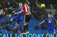 Danny Ward of Cardiff City wins the aerial ball beating John Egan of Brentford during the Sky Bet Championship match between Cardiff City and Brentford at the Cardiff City Stadium, Wales, UK. Saturday 18 November 2017