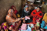 Women paying back their loans in Tanzania meet as a group and it bonds their community. If one woman can't make back her weekly loan the others will chip in to help.
