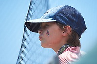 A young North Carolina State Wolfpack fan watches the action against the Northeastern Huskies at Doak Field at Dail Park on June 2, 2018 in Raleigh, North Carolina. The Wolfpack defeated the Huskies 9-2. (Brian Westerholt/Four Seam Images)