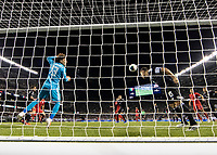 CHICAGO, IL - JULY 7: A header by Jordan Morris #11 goes towards the goal as Guillermo Ochoa #13 watches and Andres Guardado #18 prepares for a header during a game between Mexico and USMNT at Soldier Field on July 7, 2019 in Chicago, Illinois.