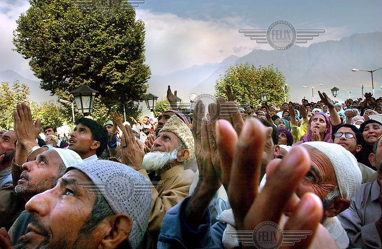 Muslims looks up at what is believed to be a relic of Prophet Mohammed's hair at the Hazratbal Shrine in Srinagar.
