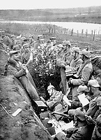 BNPS.co.uk (01202 558833)<br /> Pic: Pen&Sword/BNPS<br /> <br /> Pictured: German soldiers singing carols in their trench, alongside a lit Christmas tree.<br /> <br /> Previously unseen accounts of the First World War Christmas Day truce from the German side have come to light over 100 years on.<br /> <br /> British historian Anthony Richards has pored over hundreds of German diaries to shed new light on the temporary ceasefire in 1914.<br /> <br /> The fascinating accounts include one by a soldier who described the truce as a 'miracle' and called enemy troops his 'brothers'.